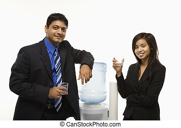 Work socializing. - Vietnamese businesswoman and Indian...