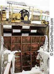 frozen river dam mechanism gate winter