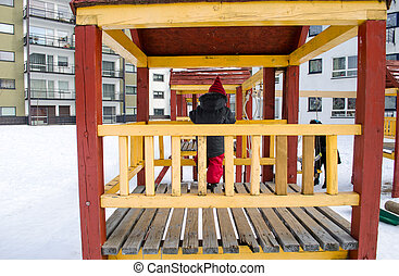 girl standing in wooden hut decorated yellow rail