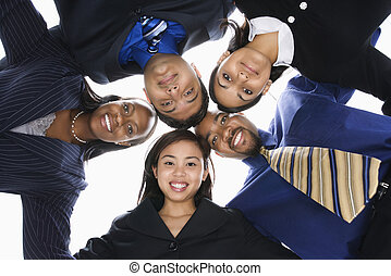 Business people in huddle. - Low angle portrait of...
