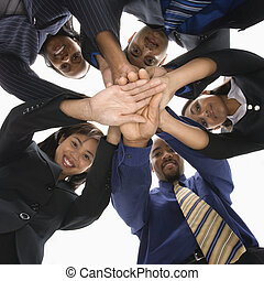 Business teamwork. - Low angle portrait of multi-ethnic...