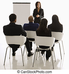 Business presentation - Vietnamese mid-adult woman standing...