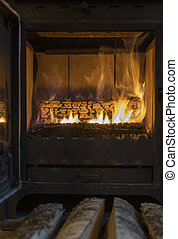 The wood in the furnace Oven door is opened - The wood in...