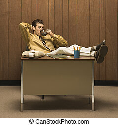 Man in retro office. - Caucasion mid-adult retro businessman...