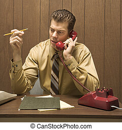 Man doing office work. - Caucasion mid-adult retro...