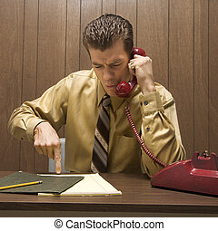 Businessman on phone - Caucasion mid-adult retro businessman...