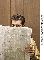 Businessman reading newspaper. - Caucasion mid-adult retro...