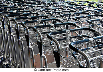 Airport luggage carts - BILBAO MAY 19 Stacked empty trolleys...