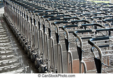 Trolleys luggage in a raw in airport - BILBAO MAY 19 Stacked...