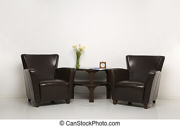 Interior seating arrangement. - Two brown armchairs and...