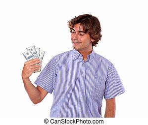 Adult stylish man smiling holding dollars.