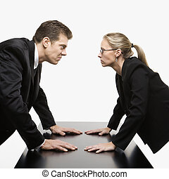 Confrontation - Caucasian mid-adult businessman and woman...