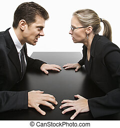 Man against woman. - Caucasian mid-adult businessman and...