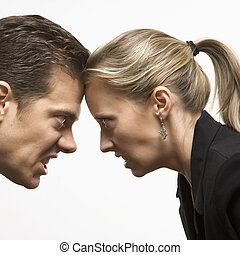 Face off. - Caucasian mid-adult man and woman with foreheads...
