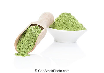Wheatgrass powder. - Ground wheat grass powder on wooden...