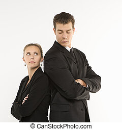 Back to back. - Caucasian mid-adult businessman and woman...