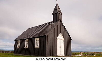 Wooden church - Loopable Timelapse of black wooden church in...