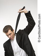 Man hanging self with necktie - Caucasian mid-adult man...