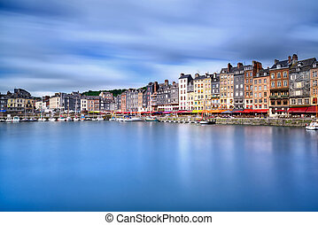Honfleur skyline harbor and water reflection. Normandy,...