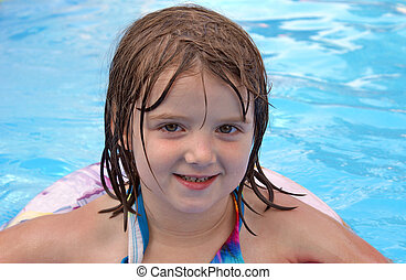 Pool Time - An adorable five year old girl enjoys some...
