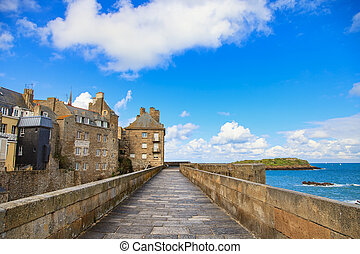 Saint Malo city walls, houses and beach. Brittany, France. -...