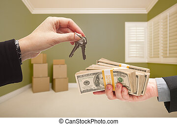 Woman Handing Over Cash For House Keys - Man and Woman...