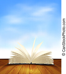 Open book on a wooden floor in front of a blue background....