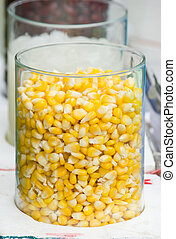 glass jar filled with corn
