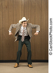 Man being playful. - Mid-adult Caucasian male wearing cowboy...