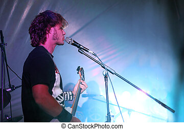 Singer in Live Rock Concert - close up on an attractive man...
