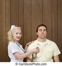 Nurse and patient - Caucasian mid-adult female nurse...
