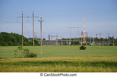 Transmission power towers in the meadow
