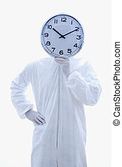 Biohazard man with clock - Man in biohazard suit holding...