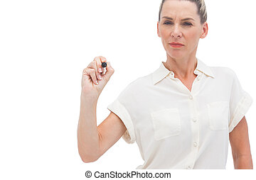 Businesswoman writing something  with a pen