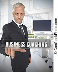 Businessman touching the term business coaching in his...