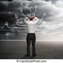Frustrated businessman looking at a drawing