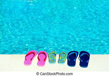Flip flops at swimming pool - flip flops at swimming pool...