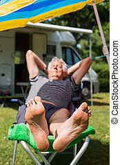 Resting at the camping - Elderly man is sleeping at the...
