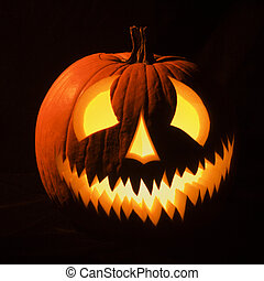Glowing jack-o'-lantern. - Carved Halloween pumpkin glowing...