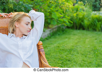 Young woman relax - Young blonde woman wearing in mans shirt...