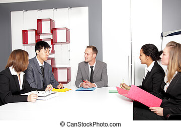 Meeting in conference room - Confident partners sharing new...