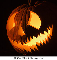 Halloween jack-o-lantern. - Carved Halloween pumpkin glowing...