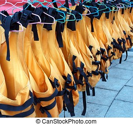 Lifejackets on Hangers - Orange life vests are drying on...