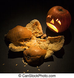 Halloween pumpkins. - Upset jack-o'-lantern looking at...