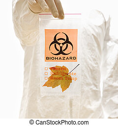 Nature concept. - Man in biohazard suit and rubber gloves...