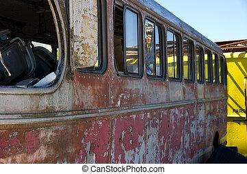 Junkyard-bus - A view of an wrecked bus in a junkyard