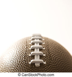 Football close up. - Close-up of American football on white...