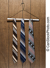 Retro patterned neckties. - Three retro ties hanging on a...