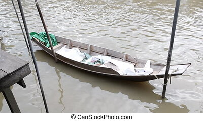 Antique wooden boat floating on the river