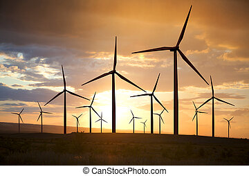 wind turbines on sunset sky